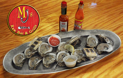 Oysters On The Half Shell at MJ's Raw Bar in New Bern, NC- A delicacy and sometimes an aphrodisiac, oyster lovers sip cold, plum, raw oysters from their freshly shucked shells. Or enjoy the fresh dish of steamed shellfish steamed to perfection! Served with drawn butter, cocktail, horseradish, salty crackers and hot saucey concoctions. - Half or Full Dozen.